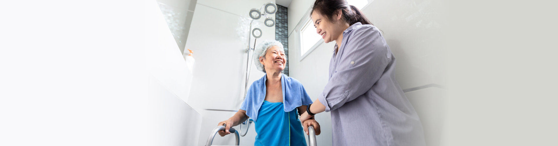 caregiver helping senior woman taking a shower